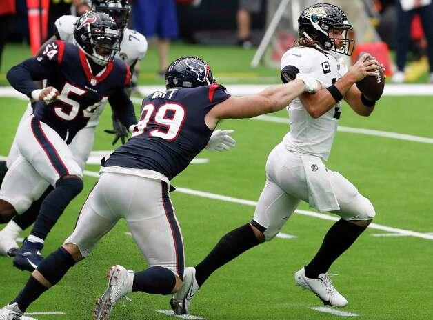 Houston Texans defensive end J.J. Watt (99) pressures Jacksonville Jaguars quarterback Gardner Minshew (15) during the fourth quarter of an NFL football game at NRG Stadium on Sunday, Oct. 11, 2020, in Houston. Photo: Brett Coomer, Staff Photographer / © 2020 Houston Chronicle