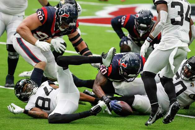 Houston Texans linebacker Tyrell Adams (50) recovers a fumble against the Jacksonville Jaguars during the fourth quarter of an NFL football game at NRG Stadium on Sunday, Oct. 11, 2020, in Houston. Photo: Brett Coomer, Staff Photographer / © 2020 Houston Chronicle