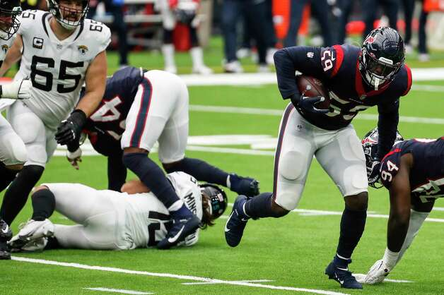 Houston Texans outside linebacker Whitney Mercilus (59) picks up a fumble after Texans linebacker Jake Martin (54) sacked Jacksonville Jaguars quarterback Gardner Minshew (15), forcing the fumble and a turnover, during the fourth quarter of an NFL football game at NRG Stadium on Sunday, Oct. 11, 2020, in Houston. Photo: Brett Coomer, Staff Photographer / © 2020 Houston Chronicle