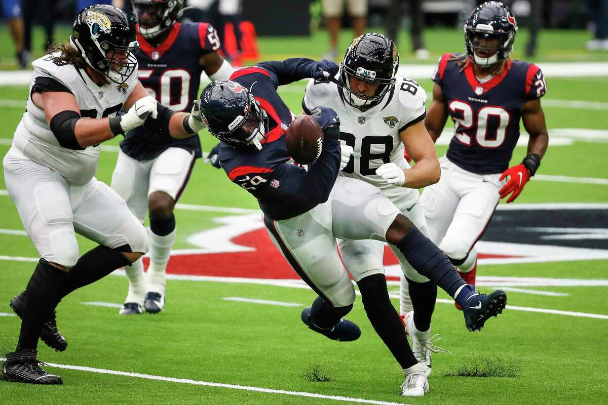 Houston Texans outside linebacker Whitney Mercilus (59) is hit by Jacksonville Jaguars tight end Tyler Eifert (88) after he picked up a fumble by Jaguars quarterback Gardner Minshew during the fourth quarter of an NFL football game at NRG Stadium on Sunday, Oct. 11, 2020, in Houston.