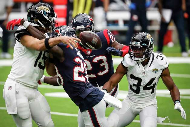 Houston Texans defensive back Michael Thomas (28) hits Jacksonville Jaguars quarterback Gardner Minshew (15) as he gets ready to release the ball during the fourth quarter of an NFL football game at NRG Stadium on Sunday, Oct. 11, 2020, in Houston. Photo: Brett Coomer, Staff Photographer / © 2020 Houston Chronicle