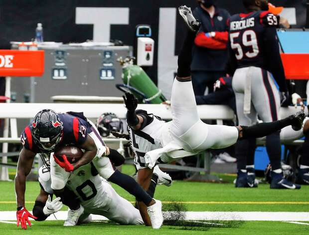 Houston Texans wide receiver Brandin Cooks (13) makes a first down reception past Jacksonville Jaguars cornerback Chris Claybrooks (27) and safety Daniel Thomas (20) during the second half of an NFL football game at NRG Stadium on Sunday, Oct. 11, 2020, in Houston. Photo: Brett Coomer, Staff Photographer / © 2020 Houston Chronicle