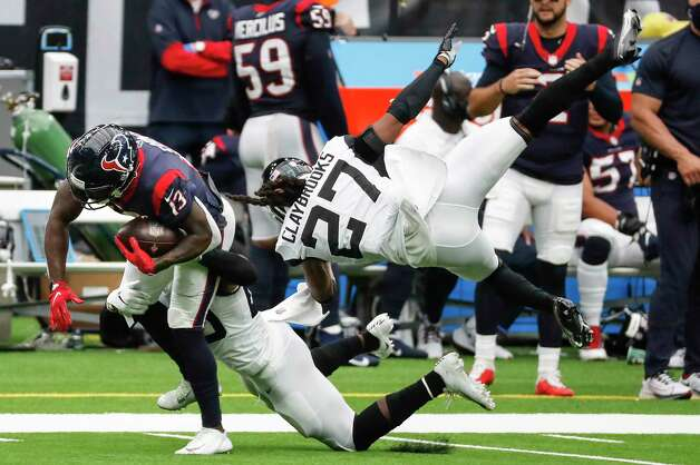 Houston Texans wide receiver Brandin Cooks (13) makes a first down reception past Jacksonville Jaguars cornerback Chris Claybrooks (27) during the second half of an NFL football game at NRG Stadium on Sunday, Oct. 11, 2020, in Houston. Photo: Brett Coomer, Staff Photographer / © 2020 Houston Chronicle