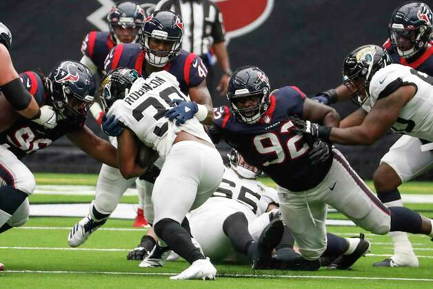 Houston Texans inside linebacker Zach Cunningham (41) stops Jacksonville Jaguars running back James Robinson (30) at the line of scrimmage during the third quarter of an NFL football game at NRG Stadium on Sunday, Oct. 11, 2020, in Houston. Photo: Brett Coomer, Staff Photographer / © 2020 Houston Chronicle