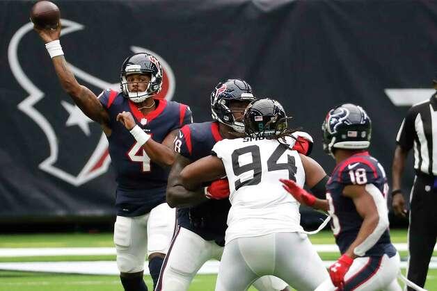 Houston Texans quarterback Deshaun Watson (4) passes to wide receiver Randall Cobb (18) during the third quarter of an NFL football game at NRG Stadium on Sunday, Oct. 11, 2020, in Houston. Photo: Brett Coomer, Staff Photographer / © 2020 Houston Chronicle