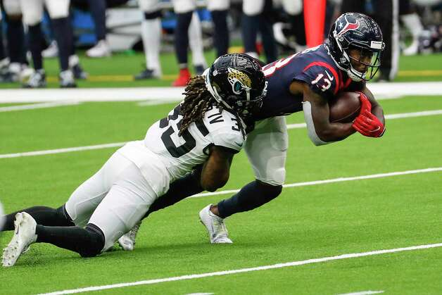 Houston Texans wide receiver Brandin Cooks (13) is tackled by Jacksonville Jaguars cornerback Sidney Jones (35) after making a catch during the third quarter of an NFL football game at NRG Stadium on Sunday, Oct. 11, 2020, in Houston. Photo: Brett Coomer, Staff Photographer / © 2020 Houston Chronicle