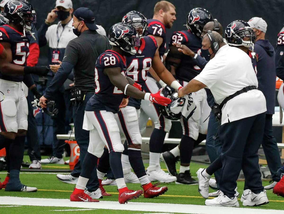 Houston Texans interim head coach Romeo Crennel greets his defense as the come off the field after picking up a turnover against the Jacksonville Jaguars during the third quarter of an NFL football game at NRG Stadium on Sunday, Oct. 11, 2020, in Houston.