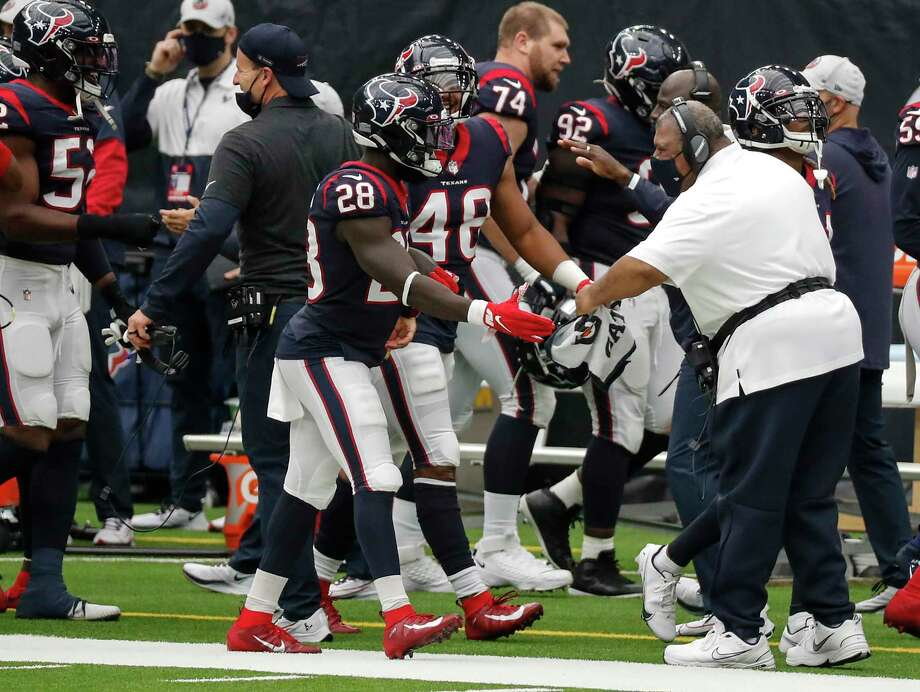 Houston Texans interim head coach Romeo Crennel greets his defense as the come off the field after picking up a turnover against the Jacksonville Jaguars during the third quarter of an NFL football game at NRG Stadium on Sunday, Oct. 11, 2020, in Houston. Photo: Brett Coomer, Staff Photographer / © 2020 Houston Chronicle