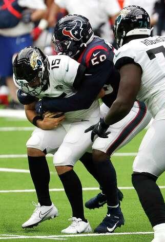 Houston Texans outside linebacker Whitney Mercilus (59) sacks Jacksonville Jaguars quarterback Gardner Minshew (15) during the third quarter of an NFL football game at NRG Stadium on Sunday, Oct. 11, 2020, in Houston. Photo: Brett Coomer, Staff Photographer / © 2020 Houston Chronicle
