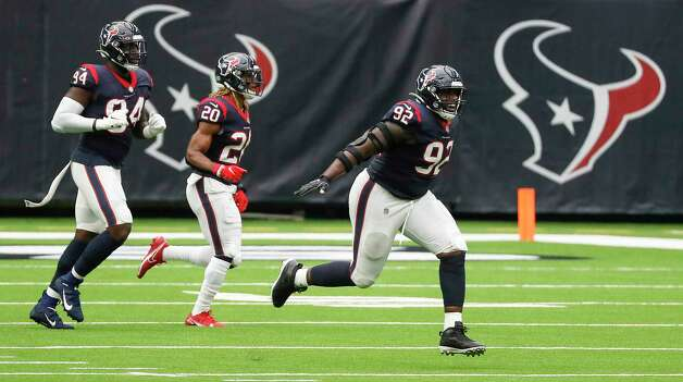 Houston Texans nose tackle Brandon Dunn (92), defensive end Charles Omenihu (94) and strong safety Justin Reid (20) celebrate after Jacksonville Jaguars kicker Stephen Hauschka missed a field goal during the first half of an NFL football game at NRG Stadium on Sunday, Oct. 11, 2020, in Houston. Photo: Brett Coomer, Staff Photographer / © 2020 Houston Chronicle