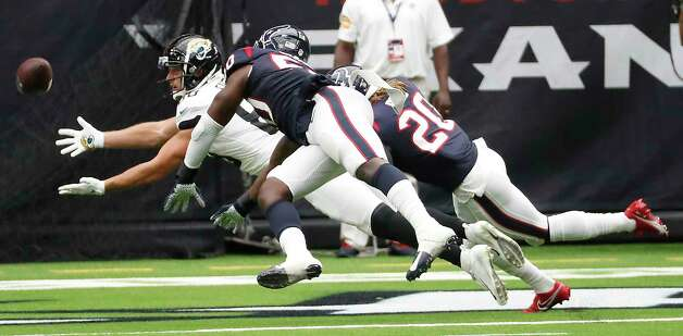 Houston Texans linebacker Tyrell Adams (50) and  strong safety Justin Reid (20) defend a pass intended for Jacksonville Jaguars tight end Tyler Eifert (88) during the first half of an NFL football game at NRG Stadium on Sunday, Oct. 11, 2020, in Houston. Photo: Brett Coomer, Staff Photographer / © 2020 Houston Chronicle