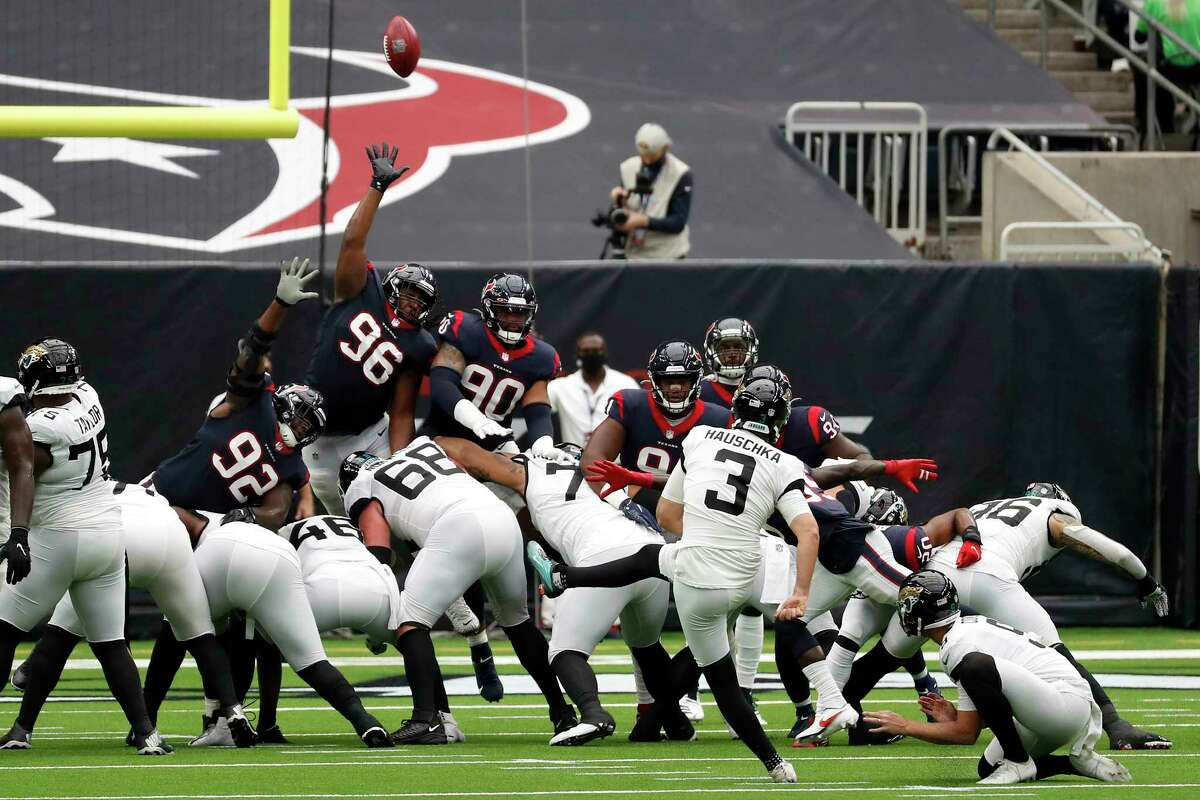 Jacksonville Jaguars kicker Stephen Hauschka (3) kicks over the Houston Texans defenders and misses a field goal attempt during the first half of an NFL football game at NRG Stadium on Sunday, Oct. 11, 2020, in Houston.
