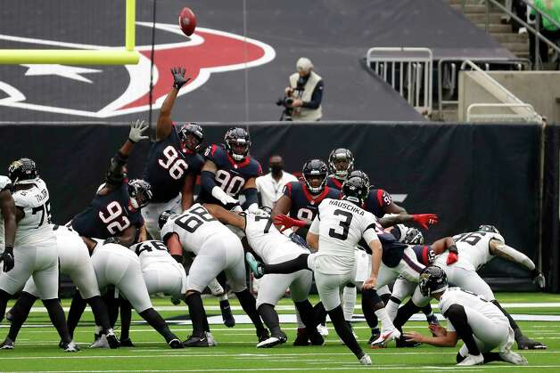 Jacksonville Jaguars kicker Stephen Hauschka (3) kicks over the Houston Texans defenders and misses a field goal attempt during the first half of an NFL football game at NRG Stadium on Sunday, Oct. 11, 2020, in Houston. Photo: Brett Coomer, Staff Photographer / © 2020 Houston Chronicle