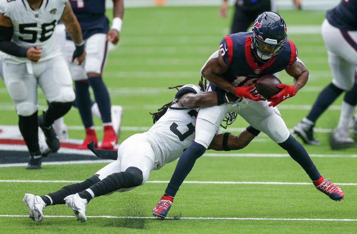 Houston Texans wide receiver Randall Cobb (18) makes a catch against Jacksonville Jaguars cornerback Tre Herndon (37) during the third quarter of an NFL game at NRG Stadium on Sunday, Oct. 11, 2020, in Houston. The Texans won 30-14.