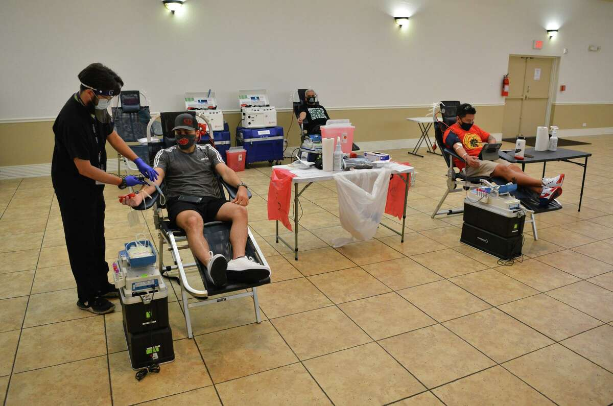 Donors Logan Henslee, Mario Moya, and Joseph Munoz are attended to by Gabriel Moreno. The South Texas blood bank is in dire need of donations, which have been cut short by the pandemic.