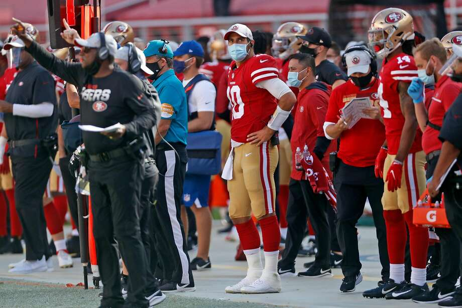 San Francisco 49ers' Jimmy Garoppolo stands on sidelines after being replaced by C.J. Beathard in 3rd quarter against Miami Dolphins during NFL game at Levi's Stadium in Santa Clara, Calif., on Sunday, October 11, 2020. Photo: Scott Strazzante / The Chronicle