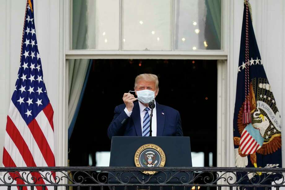 President Donald Trump removes his face mask to speak from the Blue Room Balcony of the White House to a crowd of supporters, Saturday, Oct. 10, 2020, in Washington. (AP Photo/Alex Brandon) / Copyright 2020 The Associated Press. All rights reserved.