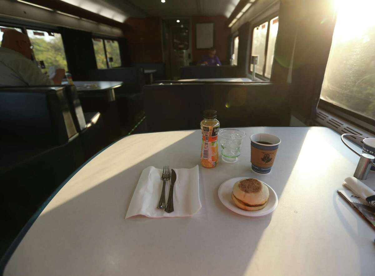 A breakfast sandwich, coffee and orange juice sits on a dining car table Sunday, Oct. 11, 2020 of the Texas Eagle. Sunday was the last daily scheduled run of the Texas Eagle. Amtrak is reducing the train's service to three days per week. The train used to have a a cook to make fresh food.