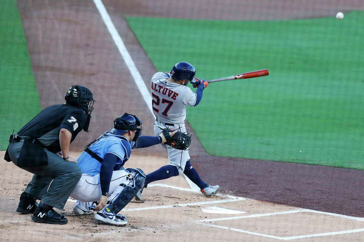 Houston Astros Jose Altuve (27) hits a solo hoe run off Tampa Bay Rays Blake Snell during the first inning of Game 1 of the American League Championship Series at Petco Park Sunday, Oct. 11, 2020, in San Diego.