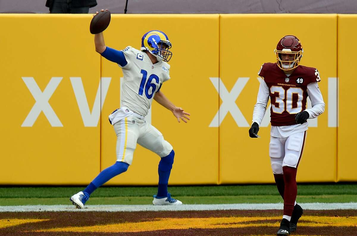 Rams QB Jared Goff attempts a celebratory spike after scampering for a second-quarter touchdown against the Washington Football Team at FedExField.