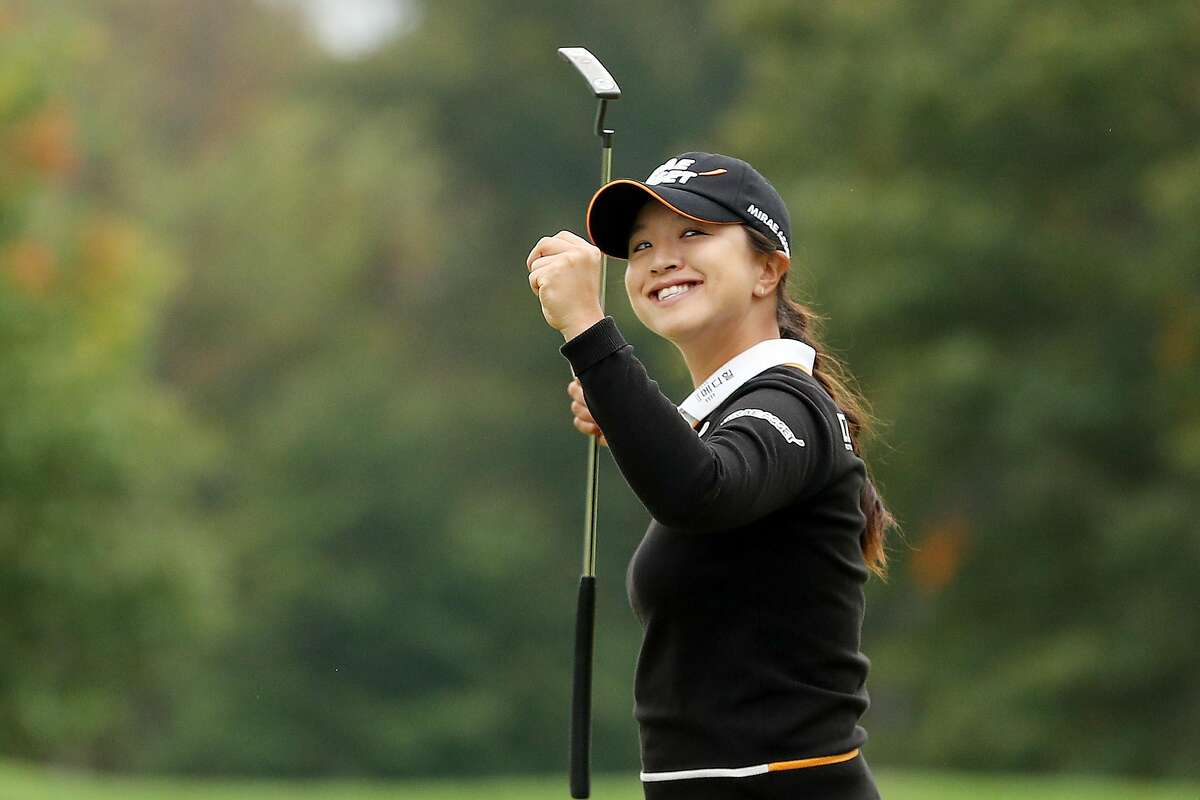 South Korea's Sei Young Kim celebrates on the 18th green after winning her first major title, at the Women's PGA Championship in Newtown Square, Pa.