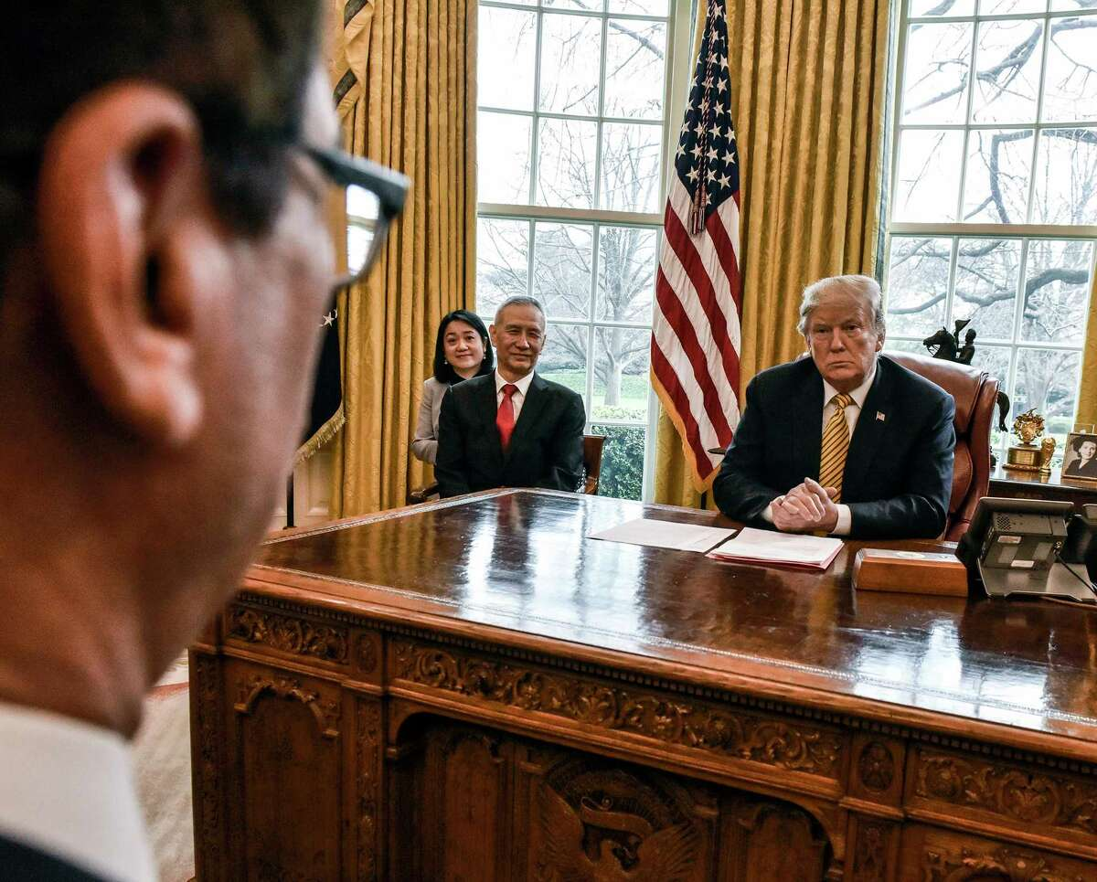 President Donald Trump talks with Treasury Secretary Steven Mnuchin, foreground left, during his meeting with Chinese Vice Premier Liu He, center, in the Oval Office on April 4, 2019.