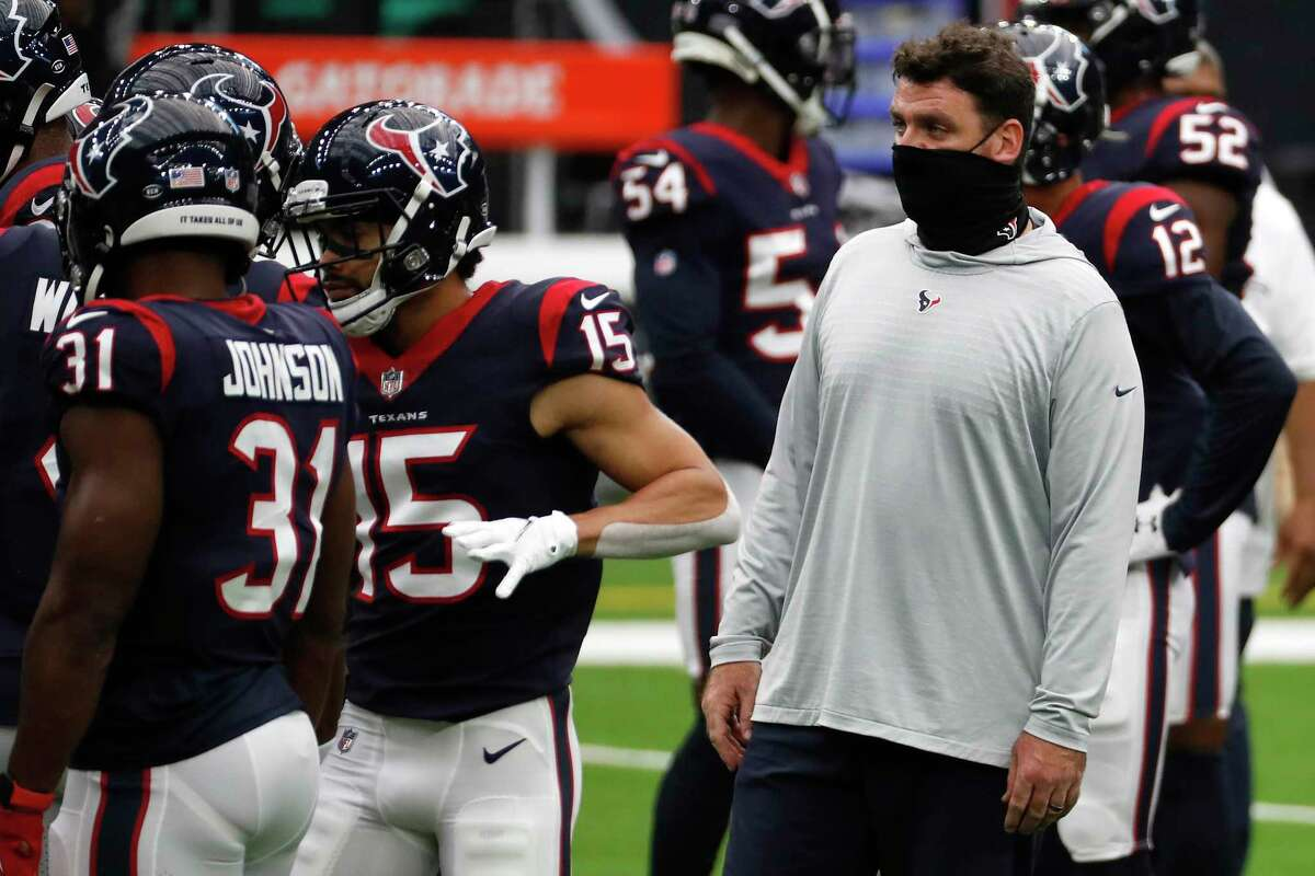 Houston Texans offensive coordinator Tim Kelly works with the offense before an NFL football game at NRG Stadium on Sunday, Oct. 11, 2020, in Houston.