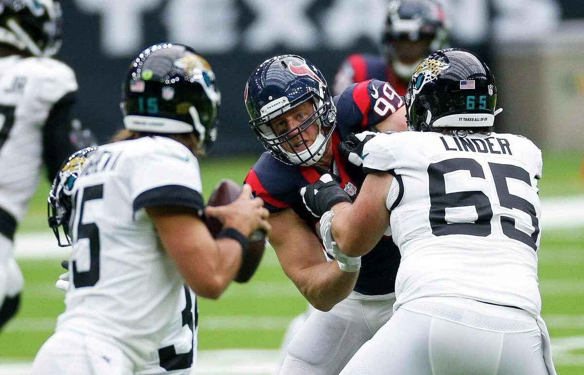 Houston Texans defensive end J.J. Watt (99) tracks Jacksonville Jaguars quarterback Gardner Minshew (15) on a pass play, during the second quarter of an NFL game at NRG Stadium on Sunday, Oct. 11, 2020, in Houston.