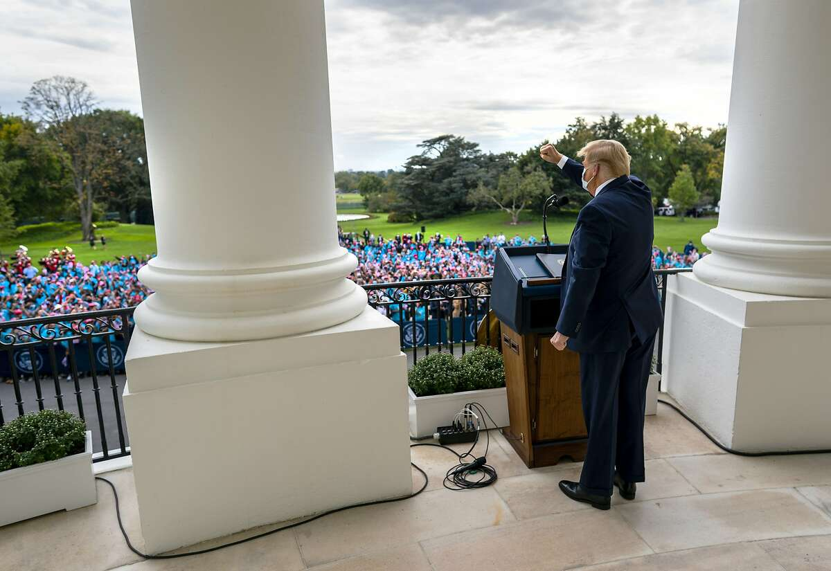 President Donald Trump acknowledges hundreds of supporters invited to the South Lawn of the White House for campaign rally, in Washington, Oct. 10, 2020. Trump, eager to prove he has fully recovered a week after being hospitalized for Covid-19, appeared briefly on Saturday afternoon in front of hundreds of chanting supporters gathered at the White House. (Doug Mills/The New York Times)