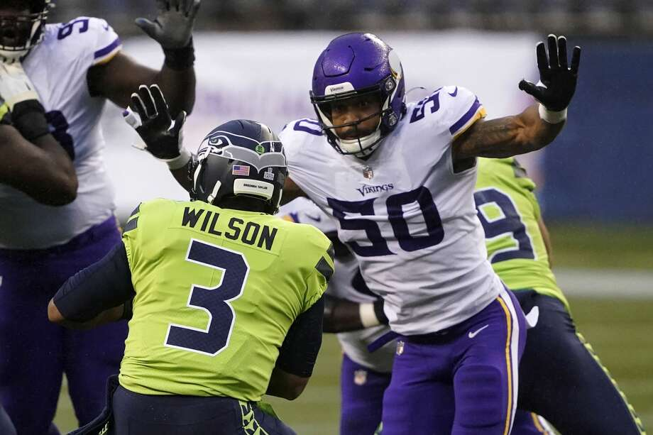 Minnesota Vikings outside linebacker Eric Wilson rushes toward Seattle Seahawks quarterback Russell Wilson before sacking him during the first half of an NFL football game, Sunday, Oct. 11, 2020, in Seattle. (AP Photo/Ted S. Warren) Photo: Ted S. Warren/AP / Copyright 2020 The Associated Press. All rights reserved.