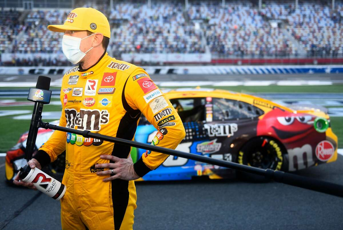 Kyle Busch speaks to reporters after the NASCAR Cup Series race at Charlotte Motor Speedway in Concord, N.C. He was eliminated from the playoffs after a 30th-place finish.