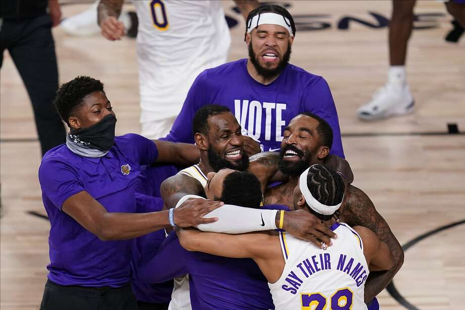 The Los Angeles Lakers players celebrate after the Lakers defeated the Miami Heat 106-93 in Game 6 of basketball's NBA Finals Sunday, Oct. 11, 2020, in Lake Buena Vista, Fla. (AP Photo/John Raoux) Photo: John Raoux, Associated Press