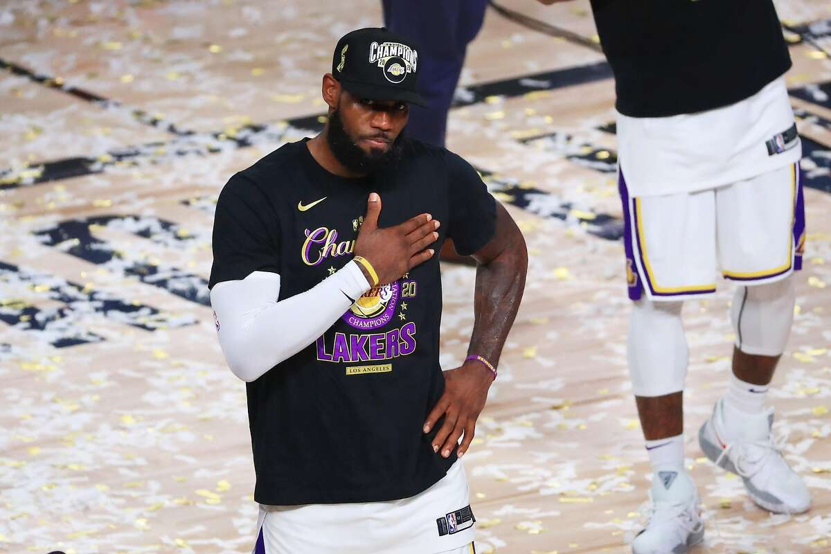 LAKE BUENA VISTA, FLORIDA - OCTOBER 11: LeBron James #23 of the Los Angeles Lakers reacts after winning the 2020 NBA Championship over the Miami Heat in Game Six of the 2020 NBA Finals at AdventHealth Arena at the ESPN Wide World Of Sports Complex on October 11, 2020 in Lake Buena Vista, Florida. NOTE TO USER: User expressly acknowledges and agrees that, by downloading and or using this photograph, User is consenting to the terms and conditions of the Getty Images License Agreement. (Photo by Mike Ehrmann/Getty Images)