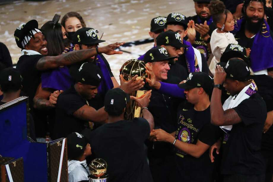 LAKE BUENA VISTA, FLORIDA - OCTOBER 11: The Los Angeles Lakers celebrate with the trophy after winning the 2020 NBA Championship Final over the Miami Heat in Game Six of the 2020 NBA Finals at AdventHealth Arena at the ESPN Wide World Of Sports Complex on October 11, 2020 in Lake Buena Vista, Florida. NOTE TO USER: User expressly acknowledges and agrees that, by downloading and or using this photograph, User is consenting to the terms and conditions of the Getty Images License Agreement. Photo: Mike Ehrmann, Getty Images / 2020 Getty Images