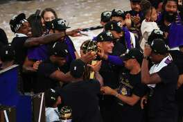 LAKE BUENA VISTA, FLORIDA - OCTOBER 11: The Los Angeles Lakers celebrate with the trophy after winning the 2020 NBA Championship Final over the Miami Heat in Game Six of the 2020 NBA Finals at AdventHealth Arena at the ESPN Wide World Of Sports Complex on October 11, 2020 in Lake Buena Vista, Florida. NOTE TO USER: User expressly acknowledges and agrees that, by downloading and or using this photograph, User is consenting to the terms and conditions of the Getty Images License Agreement.