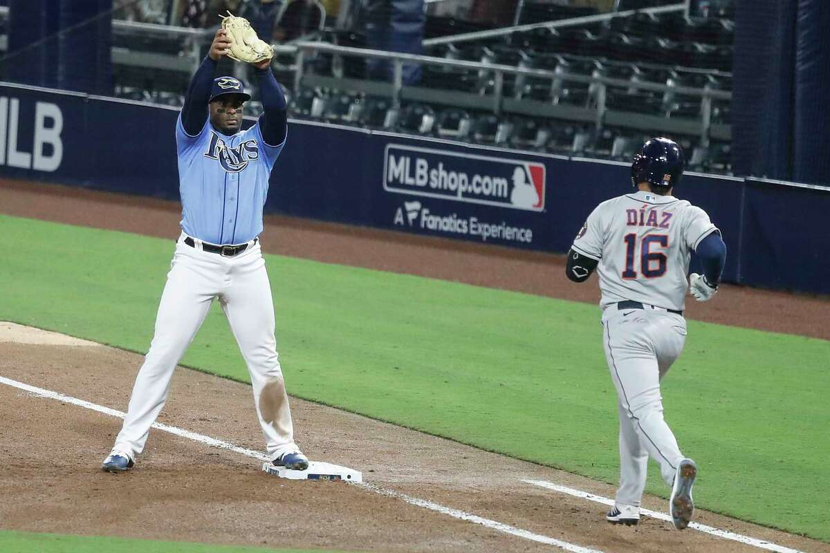 Tampa Bay Rays first baseman Yandy Diaz squeezes the ball as he records the out on a soft grounder by Houston Astros Aledmys Diaz (16) to end the sixth inning of Game 1 of the American League Championship Series at Petco Park Sunday, Oct. 11, 2020, in San Diego.