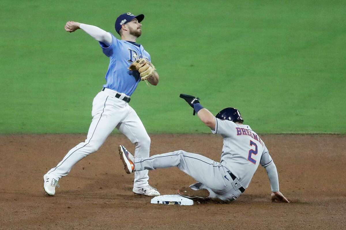 Tampa Bay Rays Brandon Lowe forces Houston Astros Alex Bregman (2) out at second on a ground ball by Carlos Correa during the sixth inning of Game 1 of the American League Championship Series at Petco Park Sunday, Oct. 11, 2020, in San Diego. Correa was safe at first on the fielder's choice.