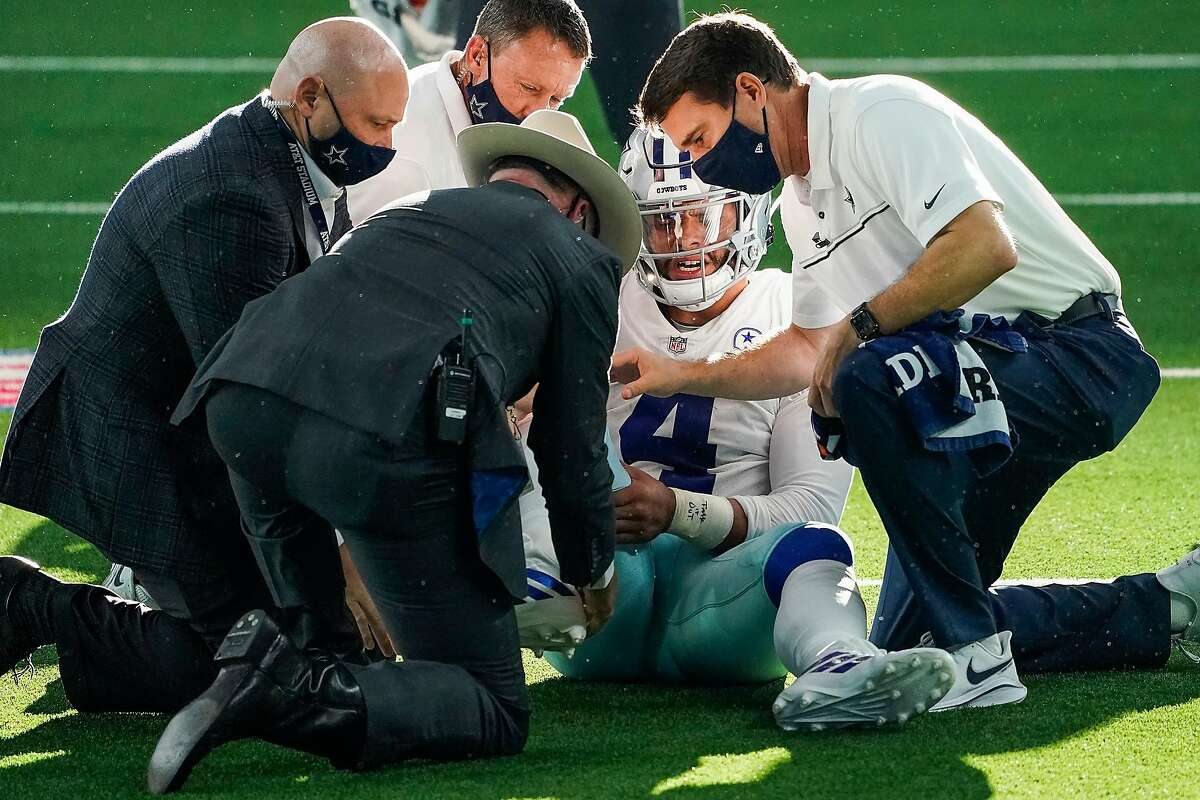 Dallas Cowboys quarterback Dak Prescott receives medical attention after being injured in the third quarter.