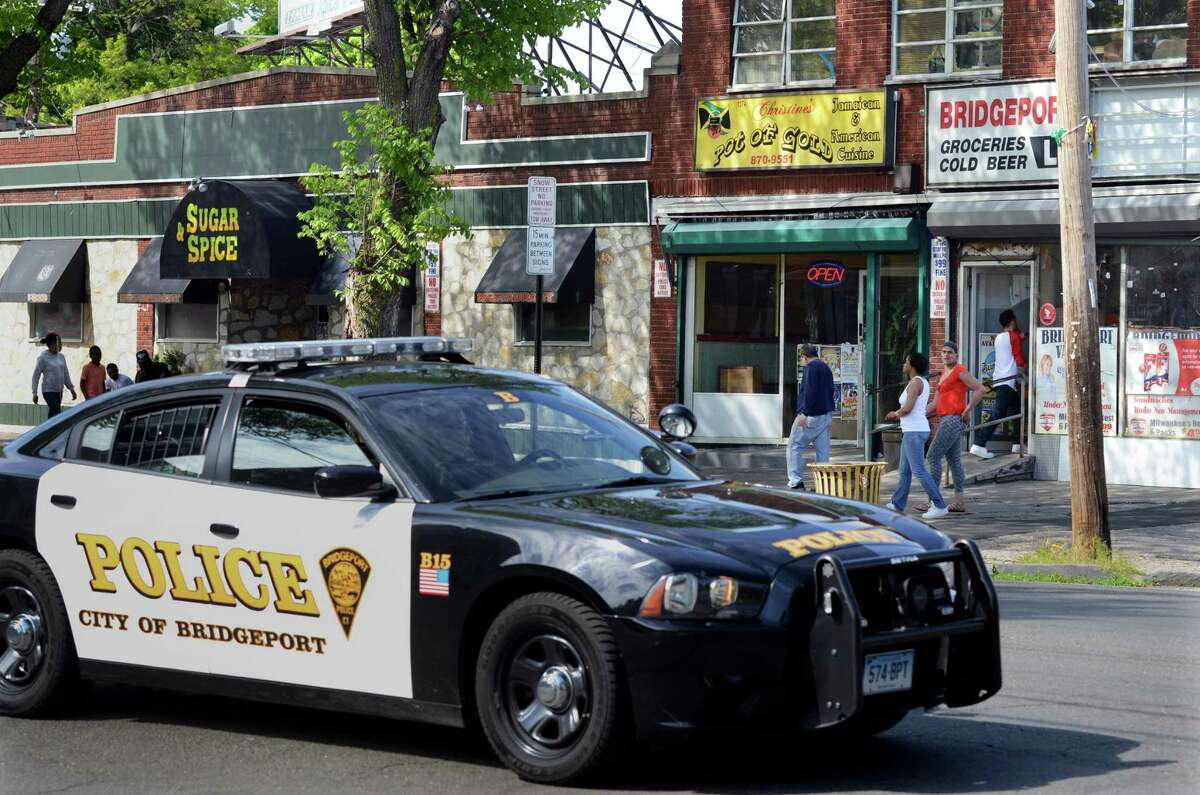 A Bridgeport police cruiser drives by along Park Ave at Olive Street in Bridgeport, Conn., on Tuesday May 17, 2016.