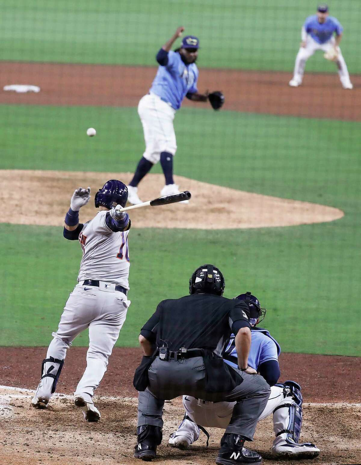 Houston Astros Yuli Gurriel (10) slaps a grounder up the middle off Tampa Bay Rays Diego Castillo that was turned in the eighth inning of Game 1 of the American League Championship Series at Petco Park Sunday, Oct. 11, 2020, in San Diego.