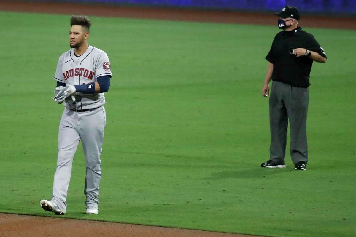 Houston Astros Yuli Gurriel (10) walks off the field after hitting into an inning-ending double play in the eighth inning of Game 1 of the American League Championship Series against the Tampa Bay Rays at Petco Park Sunday, Oct. 11, 2020, in San Diego.