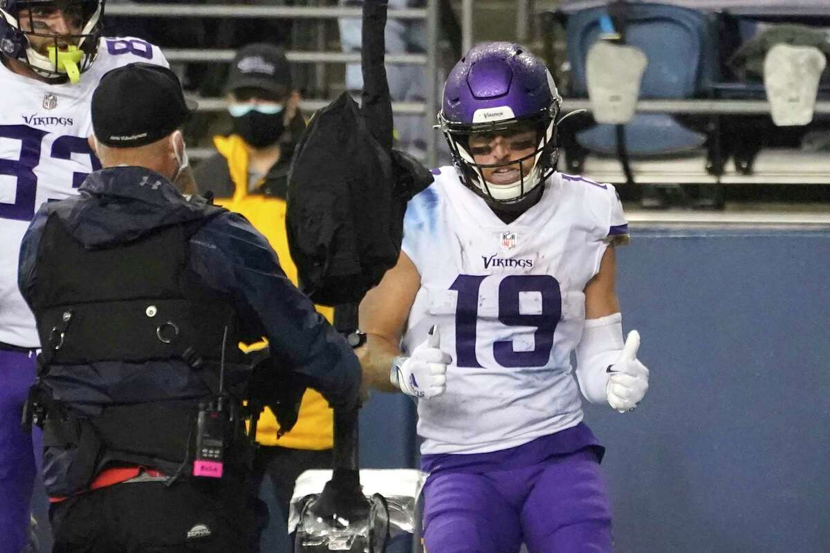 Minnesota Vikings wide receiver Adam Thielen mugs for a camera after scoring a touchdown against the Seattle Seahawks during the second half of an NFL football game, Sunday, Oct. 11, 2020, in Seattle.