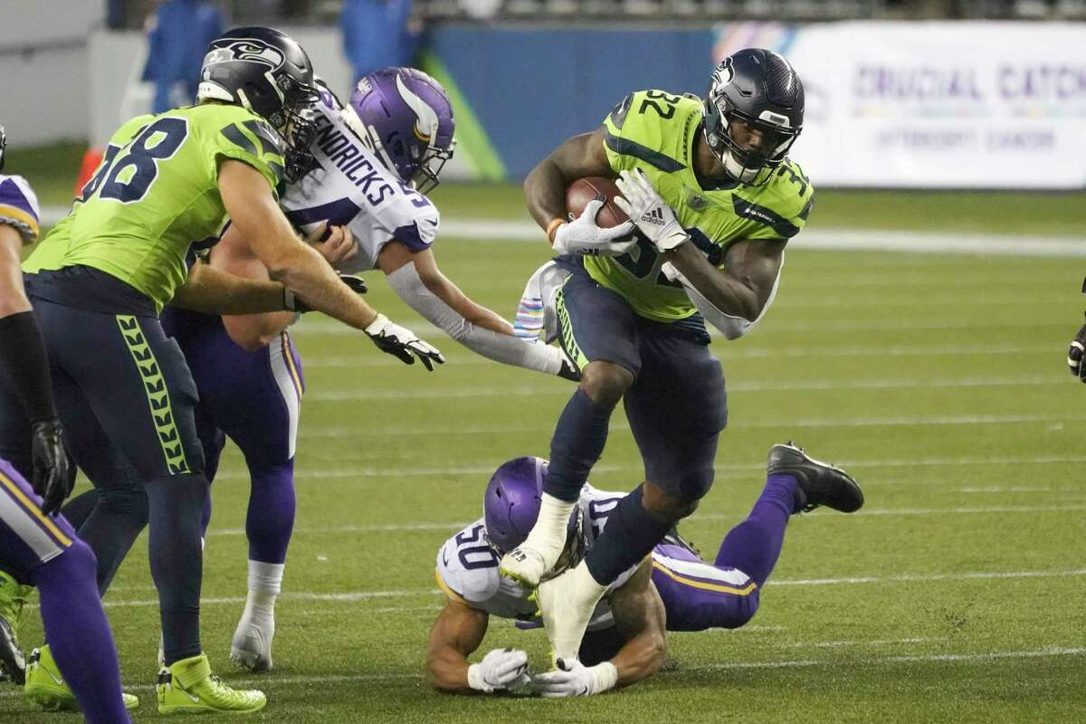 Seattle Seahawks' Chris Carson (32) rushes for a touchdown against the Minnesota Vikings during the second half of an NFL football game, Sunday, Oct. 11, 2020, in Seattle.