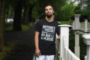 Abilis client Danny Clarke poses outside his home in Greenwich, Conn. Wednesday, Aug. 19, 2020.