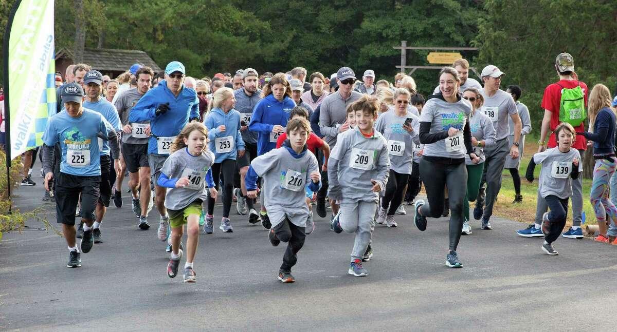 Children and adults participate in a previous Abilis walk/run event.