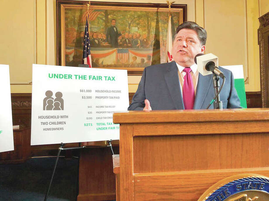 Gov. J.B. Pritzker outlines his plan to replace Illinois' flat-rate income tax with a graduated structure last year in Springfield. Both sides in the debate over changing Illinois' income tax system from a flat-rate to a graduated structure, which voters face on this fall's election ballot, have straightforward arguments. Photo: John O'Connor | AP