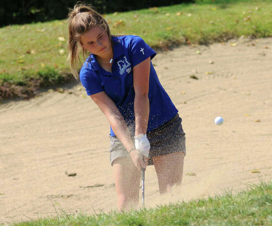 Marquette Catholic's Clancy Maag hits out of a bunker on hole No. 9 at Spencer T. Olin golf course Wednesday at the Marquette Class 1A Regional. The Explorers won their third successive regional title and will play Monday in the Salem Sectional. Photo: Greg Shashack / The Telegraph