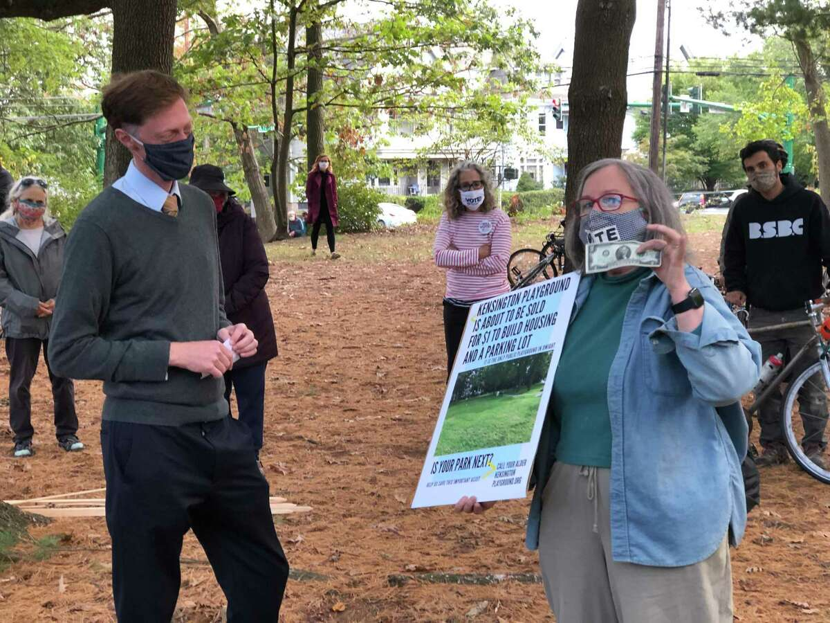 Pat Wallace symbolically offered $2 to New Haven Mayor Justin Elicker to save Kensington Park, a parcel in the Dwight neighborhood recently sold as part of an affordable housing project.