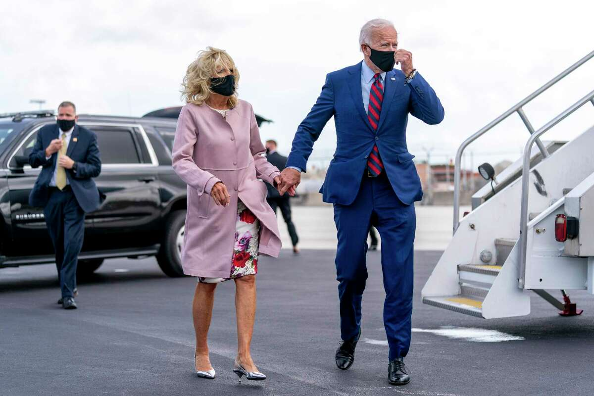 Democratic presidential candidate former Vice President Joe Biden and his wife Jill Biden arrive at Miami International Airport in Miami, Monday, Oct. 5, 2020, to travel to Little Haiti Cultural Complex. (AP Photo/Andrew Harnik)