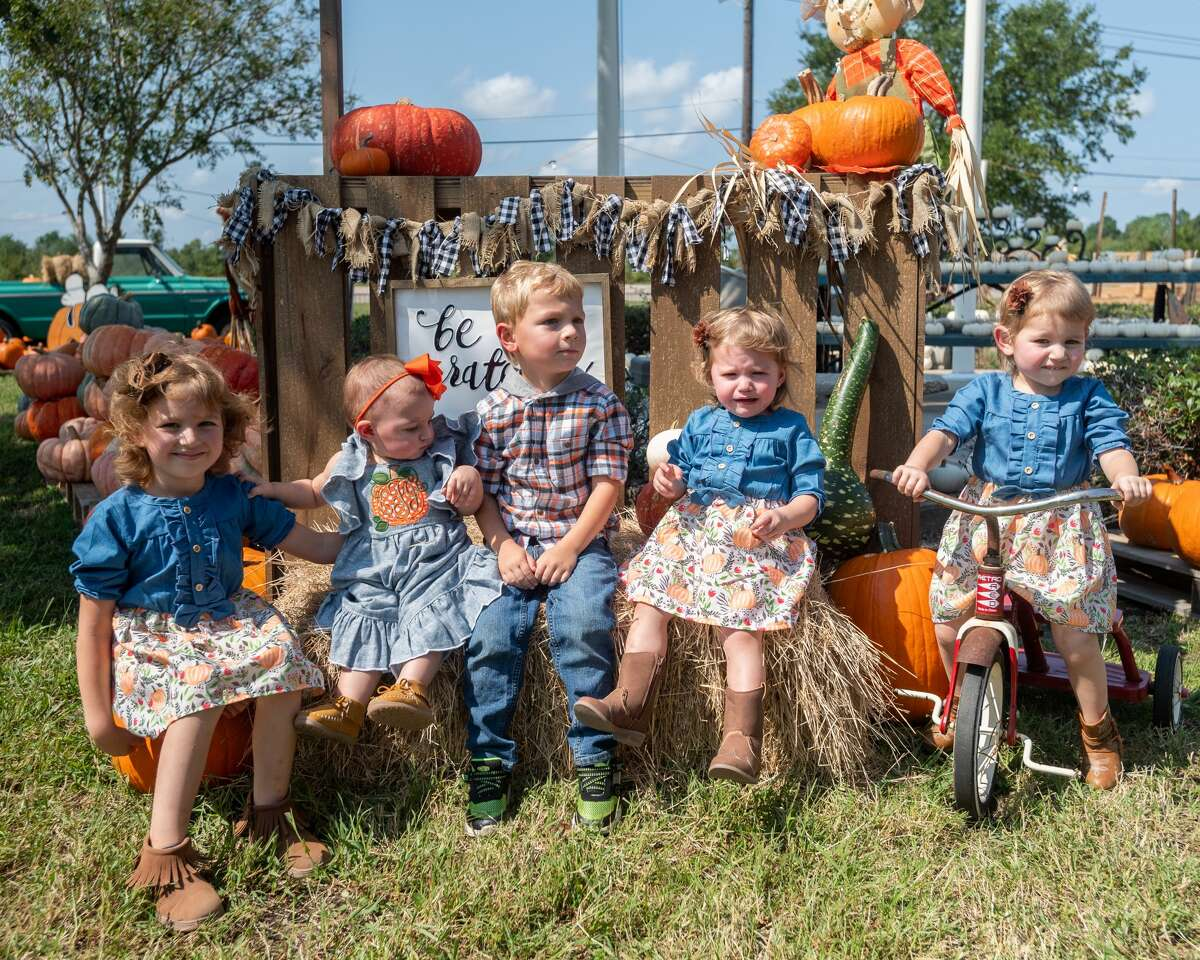 The Fowler family are posed together for a family photo in the pumpkin patch. The Pumpkin Patch at Wesley United Methodist Church opened for the season on Sunday at noon. They have a variety of pumpkins and various stations visitors can use for making fall-themed family photos while shopping. The pumpkin patch is open until October 31st, Mondays-Fridays 4pm-8pm, Saturdays 9am-8pm, and Sundays 12pm-8pm. The pumpkin patch is located at the intersection of Major and Folsom Drives in Beaumont. Photo made on October 11, 2020. Fran Ruchalski/The Enterprise